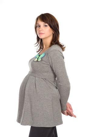 pregnant: hermosa mujer embarazada en un puente de fondo gris, blanco Foto de archivo