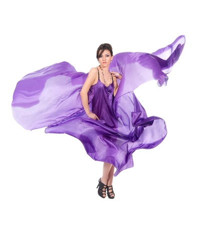 graceful girl in flying purple silk dress on a white background Stock Photo
