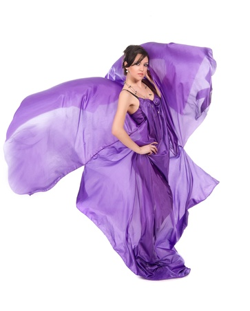 graceful girl in flying purple silk dress on a white background Stock Photo - 12832444