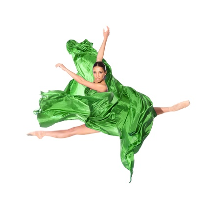 woman flying: ballet dancer in the flying jump into the tissues isolated on white background Stock Photo
