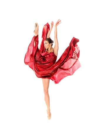 ballet dancer in the flying jump into the tissues isolated on white background Stock Photo