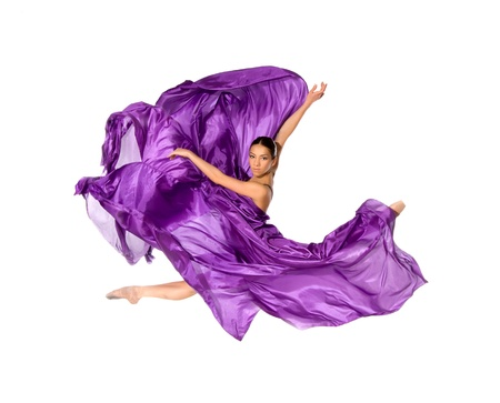 ballet dancer: ballet dancer in the flying jump into the tissues isolated on white background Stock Photo
