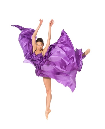ballet dancer in the flying jump into the tissues isolated on white background photo
