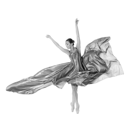ballet dancer in the flying jump into the tissues isolated on white background Фото со стока