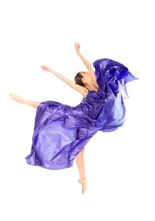 ballet shoes: ballet dancer in the flying jump into the tissues isolated on white background Stock Photo
