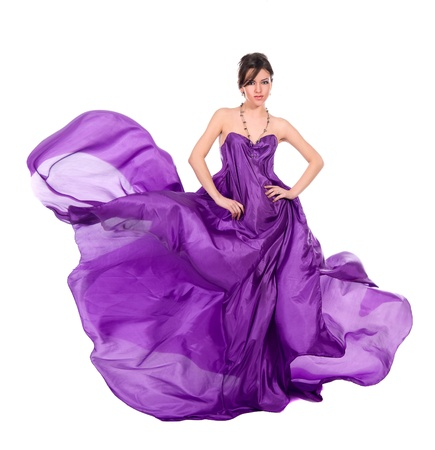 graceful girl in flying purple silk dress, isolated on a white background Stock Photo