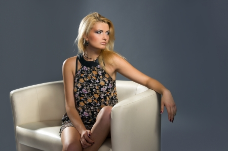 portrait of a sensual blonde with sexual Professional make-up on a gray background photo