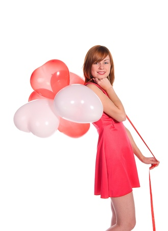 lady s: red-haired girl in a pink dress with balloons isolated on white background