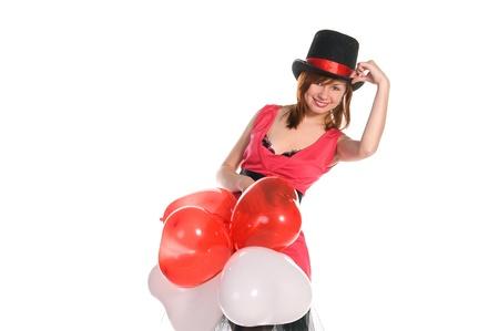 red haired girl: giovane e bella ragazza dai capelli rossi in abito rosa e cappello cilindro tenendo palloncini a forma di cuore