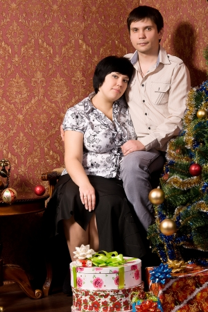 Portrait of amorous couple in a room with a vintage retro wallpaper photo