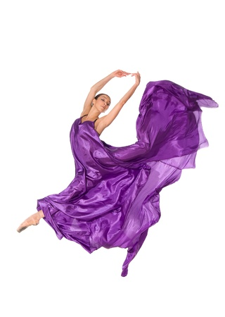 ballet dancer in flying satin dress isolated on white background photo