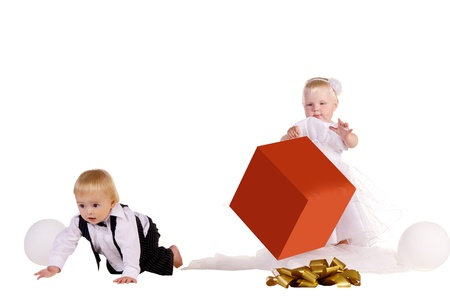 little boy and girl with a big box in hands, isolated on white background photo