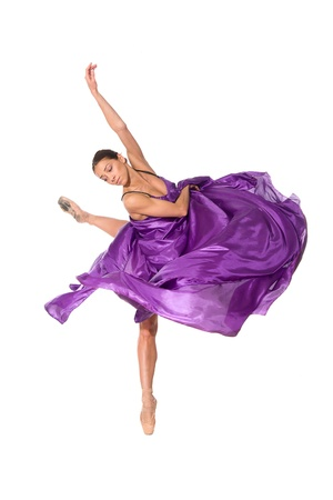 purple dress: ballet dancer in flying satin dress isolated on white background