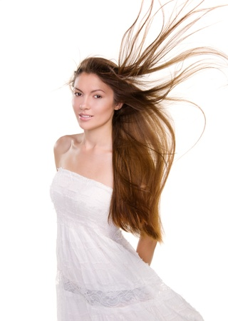 wind dress: Portrait beautiful girl with long hairs and clean skin face - isolated on white background Stock Photo