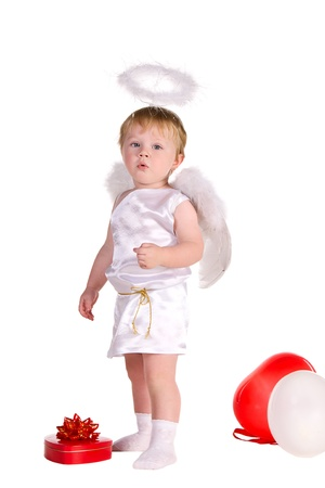 boy dressed as angel with white and red balloons isolated on white background photo