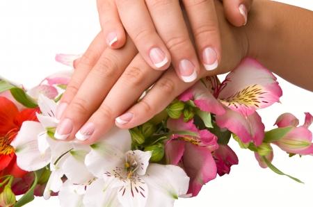 cuidado de las uñas de las manos de la mujer, aislados en fondo blanco Foto de archivo