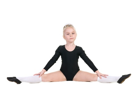little ballerina in black bathing suit training isolated on white background photo