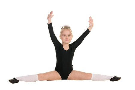 ballerina tights: little ballerina in black bathing suit training isolated on white background