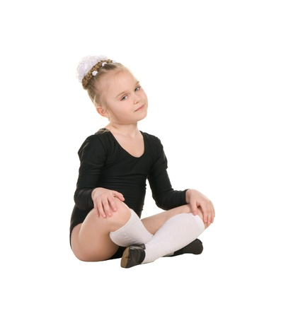 little ballerina in black bathing suit training isolated on white background
