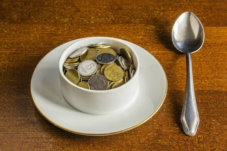 Soup plate, spoon and money.