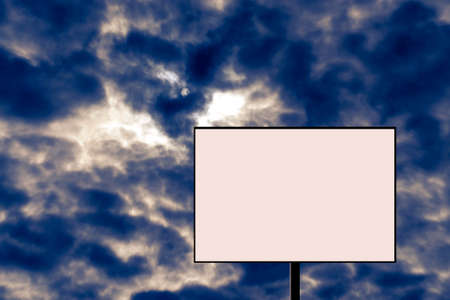 Blank billboard against a stormy sky. Alarming, dangerous news