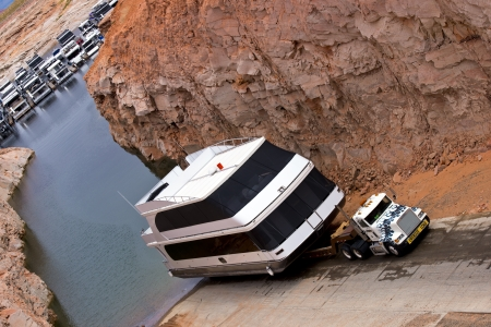 Large truck exports from the lake to land a big boat, Lake Powell, Arizona Editorial