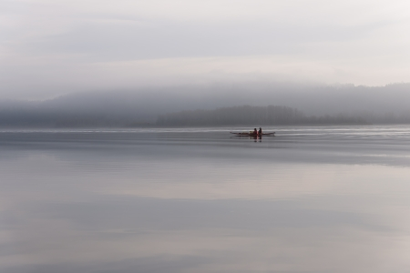 Canoeing on the Columbia river in fog weather  The silence of nature soothes and relaxes two people Stock fotó