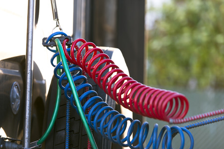 Bracket on the spring, which suspended the red, blue and green air hoses and wires to connect the truck and trailer Stock Photo - 25858158