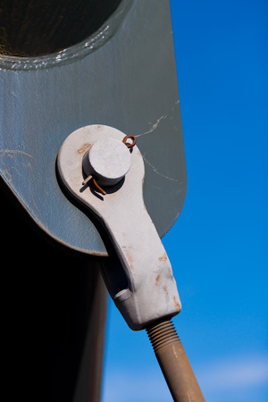 Metal bracket with a pin fixing threaded bridge tie against the blue sky Stock Photo - 26714070
