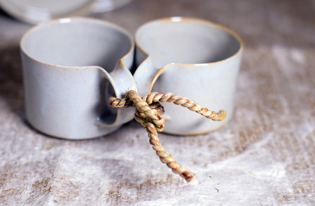 inseparable: Two mod cups tied by rope together as a symbol of loyalty and inseparable, as a symbol of love and friendship, as a symbol of reconciliation and peace