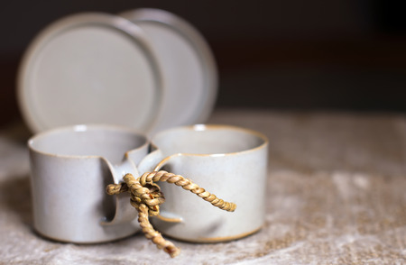 inseparable: Two mod cups tied by rope together as a symbol of loyalty and inseparable, as a symbol of love and friendship, as a symbol of reconciliation and peace in the family