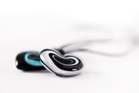 inseparable: Two elegant heart made %u200B%u200Bof glass on blurred bright