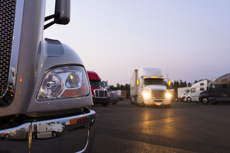 Fragment of the modern parts of the truck on a night truck stop in the foreground Stock fotó - 32504394