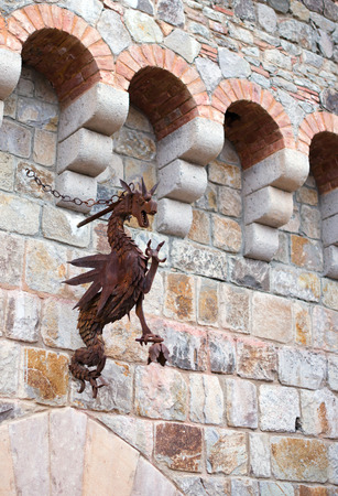 medieval blacksmith: figure of a dragon with wings and open mouth  Stock Photo