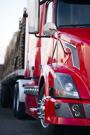 Beautiful modern and stylish semi truck trailer loaded with pipes with reflection