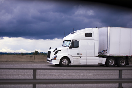 truck: Contemporary modern and comfortable luxury white big rig semi truck with a trailer  Stock Photo