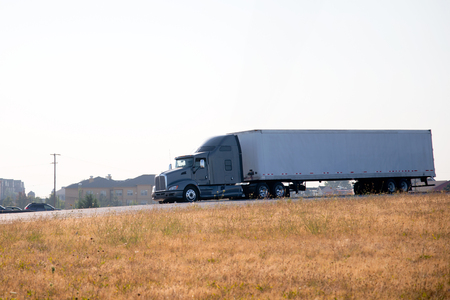 The powerful beast of prey - a semi truck with a trailer, as the real master of the jungle - the roads moving robust tread on its territory forward to victory. The present professional standard of productive commercial transportation of industrial product