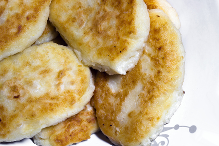 home cooked: Nutrient ruddy fried potato pancakes in the form of pastries laid out on a plate and ready to eat at the family dinner table. It refers to a handmade food product in home cooked and contains a lot of mineral and nutrients. The dish is part of a popular Uk Stock Photo
