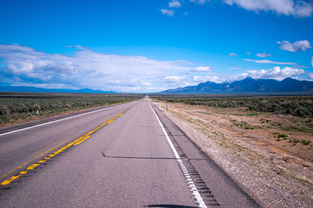 going nowhere: Endless dream, endless imagination, endless road life-long. Landscape with the endless road in Nevada stretches to the horizon as the eye can see.