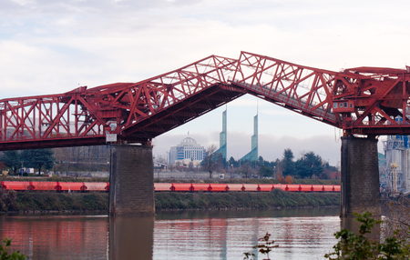 Lifting truss drawbridge Broadway bridge across the Willamette river in the heart of Portland Oregon with raised sections with movable towers Convention Center in the background Reklamní fotografie