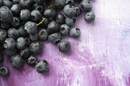 savour: Berries of blueberries are poured onto the canvas as a true masterpiece of nature, full of vitamins and nutrients, capable of restoring strength and imparting vivacity, satisfying hunger and helping to keep the figure flexible and graceful
