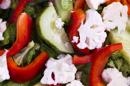 A nutritious low-calorie salad made from freshly sliced vegetables Foto de archivo