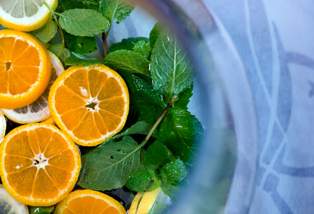 Delicious healthy exotic nature refreshing drink with mint and lemon have a wonderful taste and a light aroma of mint and citrus create an excellent atmosphere of celebration and relaxation at the same time Stock Photo