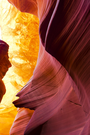 Like big burning fire on the sandstone curved walls of the slot canyon of the Lower Antelope Canyon in Page city in state of Arizona attracts and fascinates the sight