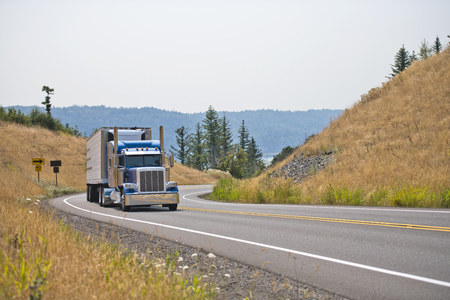 Owner - operators are the main core of the drivers of classic big rig semi trucks engaged in the transport of perishable goods in refrigerated trailers delivering goods in time to their places of use Stok Fotoğraf