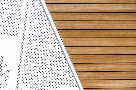 Modern two-part background connected with diagonally natural wooden lacquered slats and a pattern with grouped check points on a white background