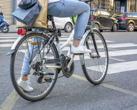 Riding a bike in Paris is not only useful but also beautiful. Cycling combines the elegance of movements emphasizing the advantages of a female figure and effect of a slim elastic body