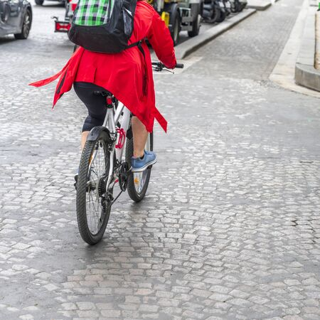 Riding a bike is not only useful but also beautiful. Cycling combines the elegance of movements emphasizing the advantages of a female figure dressed in a tight fit and effect of a slim elastic body