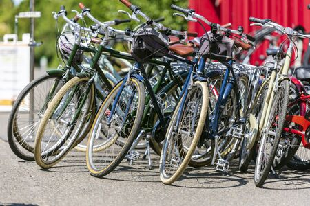 Bicycles for rent and city trips are standing near the container waiting for cyclists. The use of a bicycle as the main transport for many enthusiasts has grown from a hobby into vital necessity