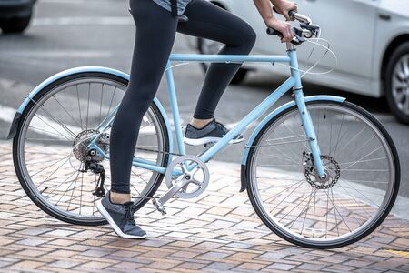 Woman on bicycle and cycling rides are great tools for improving the health of the muscles of the hip belt reducing weight and improving female libido improving psychological stability in lifestyle Reklamní fotografie - 129030535